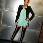 Cassie-in-Alexander-McQueen-lace-up-boots